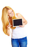Blonde woman with a blackboard Royalty Free Stock Photos