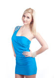 Blonde woman in blue dress Stock Images