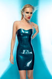 Blonde woman in blue latex dress Royalty Free Stock Photo