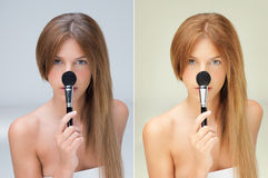 Blonde woman with blush brush on her nose Royalty Free Stock Image