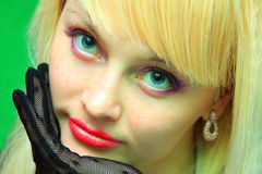 Blonde woman with bright makeup Royalty Free Stock Image