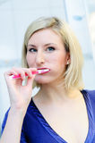 Blonde Woman brushing her Teeth stock photos
