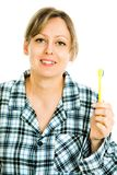 Blonde woman brushing teeth, cleaning - everyday`s routine activity royalty free stock images