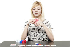 Blonde woman in business attire playing poker gambling Stock Image