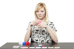 Blonde woman in business attire playing poker gambling Stock Photos