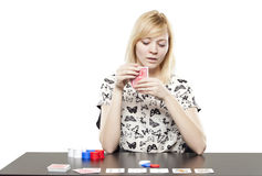Blonde woman in business attire playing poker gambling Royalty Free Stock Photo
