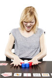 Blonde woman in business attire playing poker gambling Royalty Free Stock Images