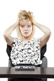Blonde woman in business attire very angry and upset at desk Stock Photos