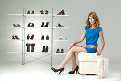 Blonde Woman Buying Shoes Stock Image