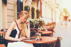 Blonde woman in cafe with digital tablet Royalty Free Stock Photo