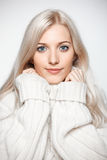 Blonde woman in cashmere sweater Royalty Free Stock Image