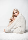 Blonde woman in cashmere sweater Stock Images