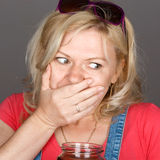 Blonde woman caught on breaking diet Royalty Free Stock Photo