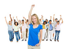 Blonde Woman Celebrating With Diverse People Stock Images