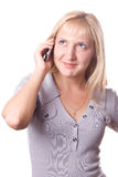 Blonde woman with cell phone isolated. #2. Blonde woman making a call with cell phone in her hand. Isolated on white. #2 royalty free stock photography