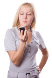 Blonde woman with cell phone isolated. #3. Blonde woman thinking with cell phone in her hand. Isolated on white. #3 stock photos