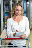 Blonde woman checking list Royalty Free Stock Image