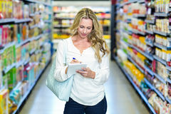 Blonde woman checking list Royalty Free Stock Images