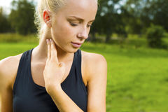 Blonde woman checks her pulse after a long run Stock Photography