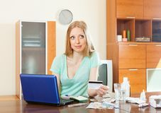 Blonde woman choosing medication online Stock Images