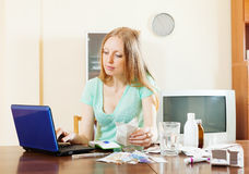 Blonde  woman choosing medication online pharmacy Stock Photography