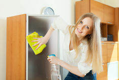 Blonde woman cleaning  glass Royalty Free Stock Photography