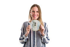 Blonde woman with a clock showing the time, isolated on white Stock Photo