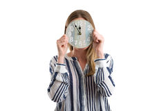 Blonde woman with a clock showing the time, isolated on white Stock Images