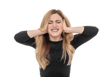 Blonde woman closing ears with fingers. Royalty Free Stock Image