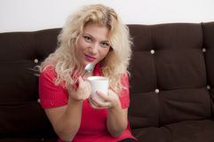 Blonde Woman with a coffe mug Royalty Free Stock Photography