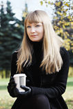 Blonde woman with coffee cup Stock Photo