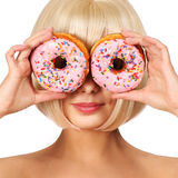 Blonde woman with colorful donuts isolated royalty free stock photos