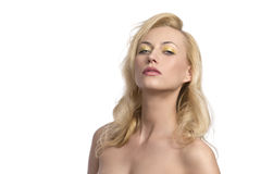 Blonde woman with colorful make-up. Portrait of sexy blonde woman with long natural hair-style, colorful make-up and naked shoulders Stock Photos