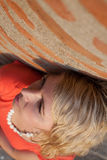 Blonde woman contemplating and looking up. She is photographed from above and close-up Royalty Free Stock Photos