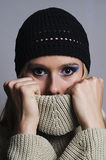 Blonde woman covering her face with turtleneck vertical Stock Photos