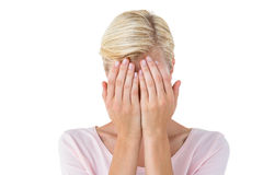 Blonde woman covering her face Royalty Free Stock Photography