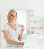 Blonde woman with credit card and notebook Stock Photos