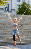 Blonde woman with crutches Royalty Free Stock Photography