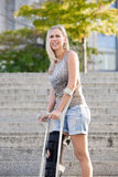 Blonde woman with crutches Royalty Free Stock Image