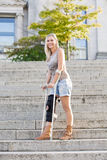 Blonde woman with crutches Stock Photography