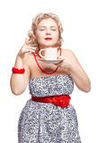 Blonde woman with cup Stock Image