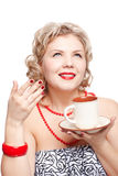 Blonde woman with cup Stock Photography