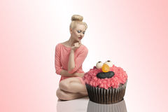 Blonde woman with cupcakes Royalty Free Stock Photo