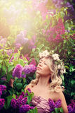 Blonde Woman with Curly Hair and Flowers Wreath in Sunli Royalty Free Stock Photo