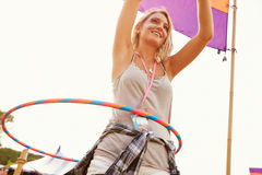 Blonde woman dancing with hula hoop at a music festival Stock Photography