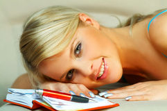 Blonde woman with datebook Royalty Free Stock Image