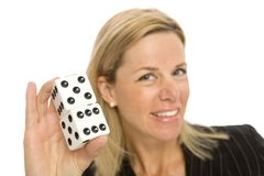 Blonde woman with dice. A blonde woman holds up a large pair of dice Stock Images