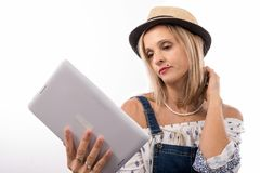 Blonde  woman with digital tablet, on white. Pretty blonde woman with digital tablet, on white Royalty Free Stock Photography