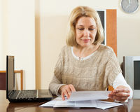 Blonde woman with documents Stock Photos