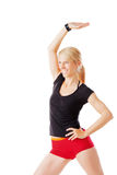 Blonde woman doing exercises. Isolated on white Royalty Free Stock Photography